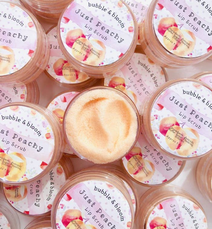 "A small container of peach-colored ""just peachy"" lip scrub"
