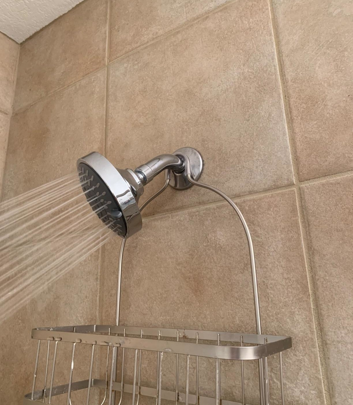 reviewer image of the warmspray shower head spraying high pressure water on the rain setting