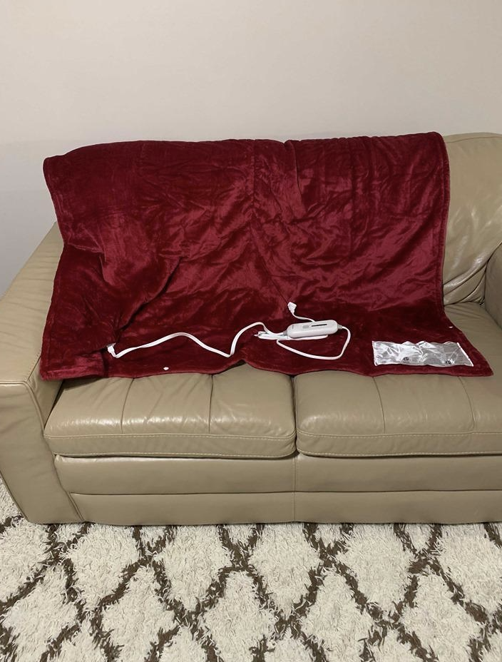 reviewer image of heated blanket in red on couch