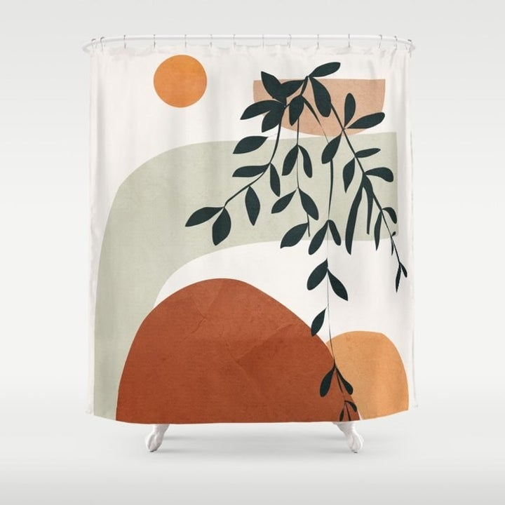Shower curtain with sun, geometric red, green, pink, and yellow arcs and an ivy leaf design