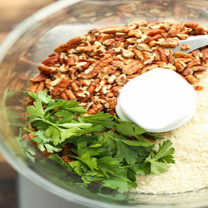 Ingredients for pecan crust in a food processor.