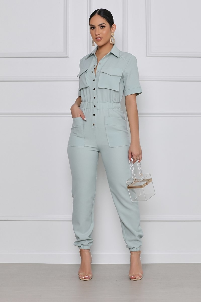 model wearing the short-sleeve collared jumpsuit