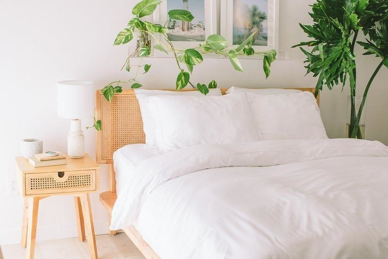 a white bedding set on a bed