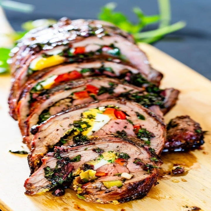 A flank steak stuffed with herbs, peppers, and hard boiled egg.