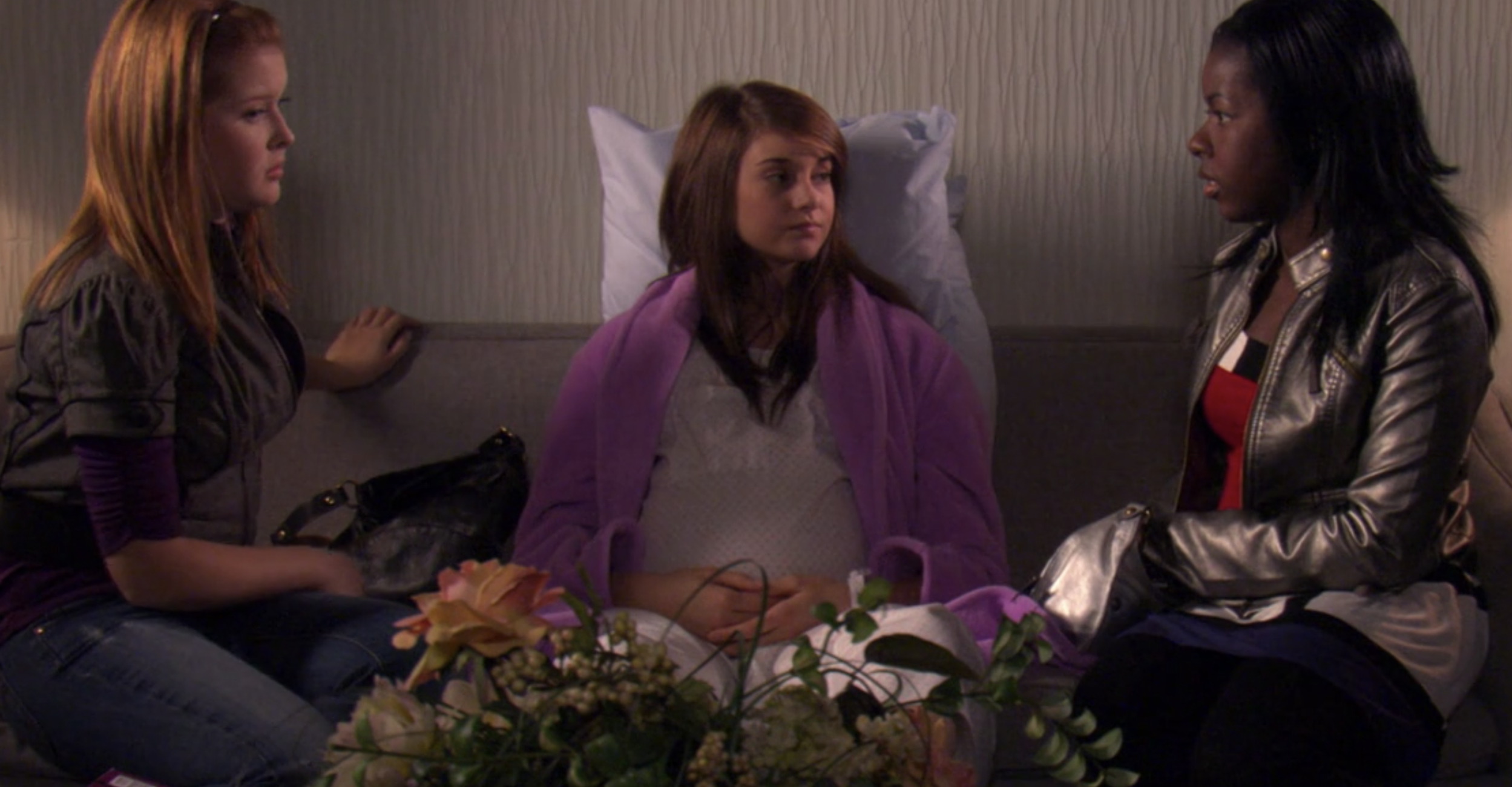 "Amy from ""The Secret Life of the American Teenager"" 9 months pregnant sitting on a couch in the hospital"