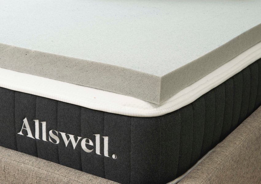 the memory foam topper on a bed