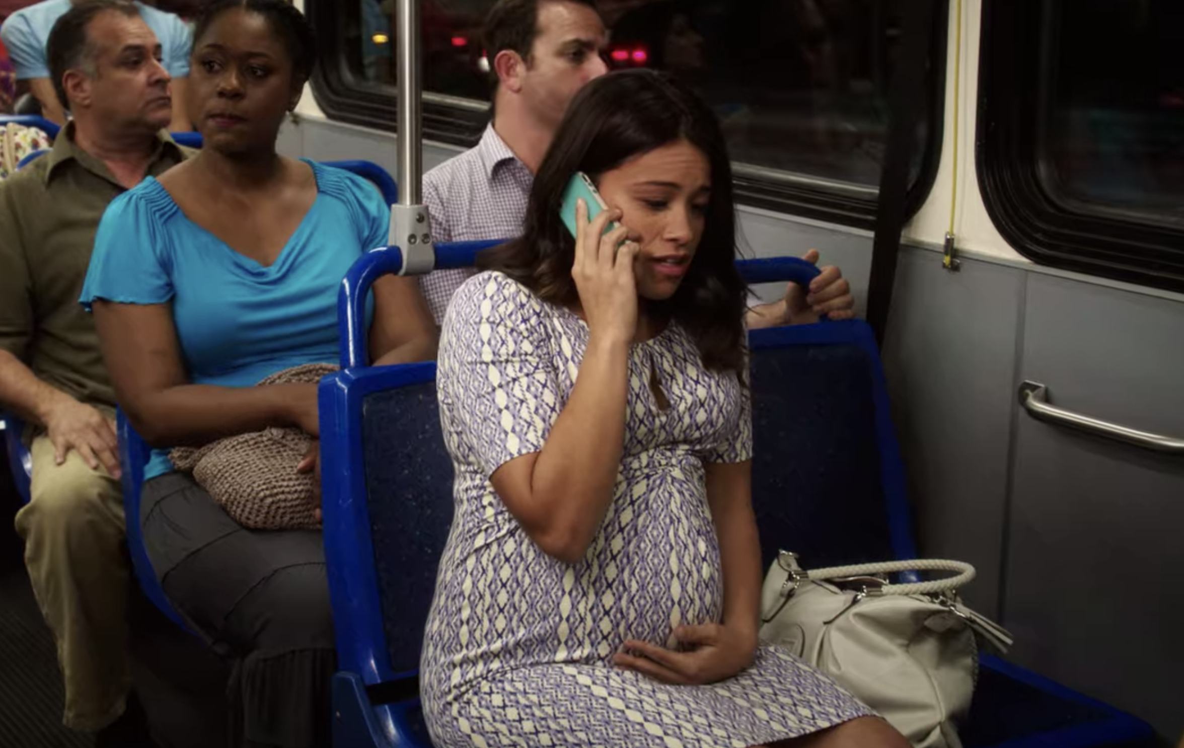 "Jane from ""Jane the Virgin"" sitting on the bus while 9 months pregnant"