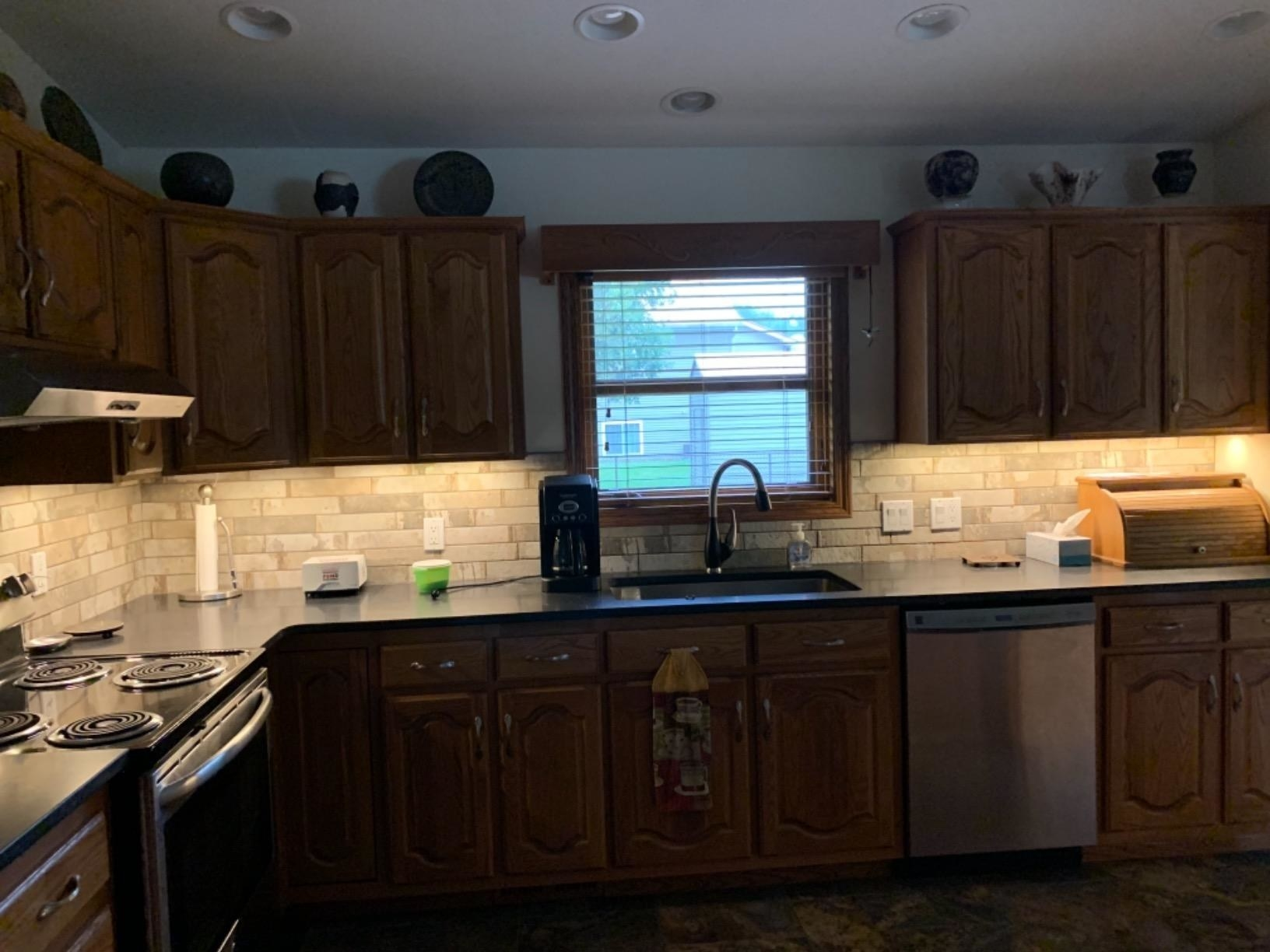 reviewer image of under cabinet LED lights turned on in a customer's kitchen