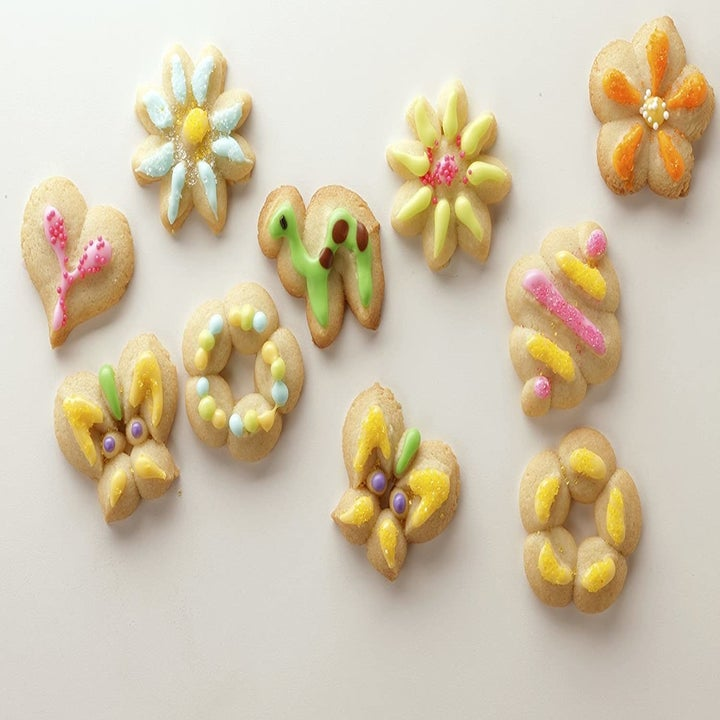Several cookies in different shapes with multi-colored frosting decorations