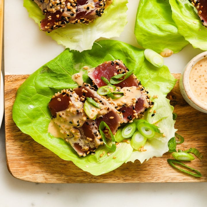 Seared ahi tuna in a lettuce cup with sesame dressing.