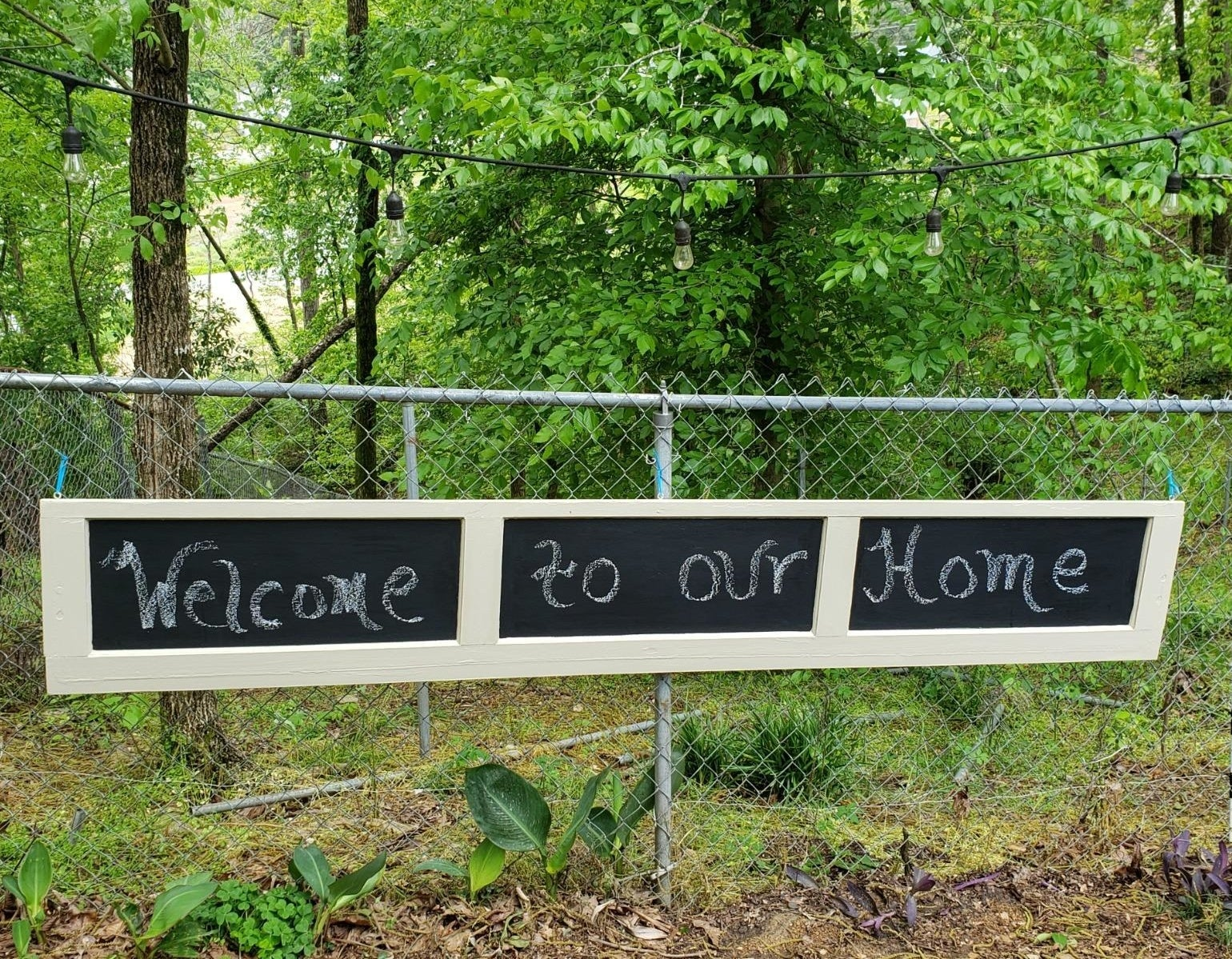 "reviewer image of garage door panel with chalkboard paint and a message that reads ""welcome to our home"" in chalk"