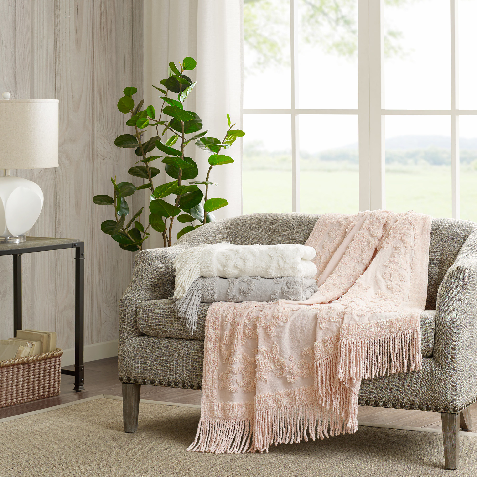 The blankets in pink, gray and white