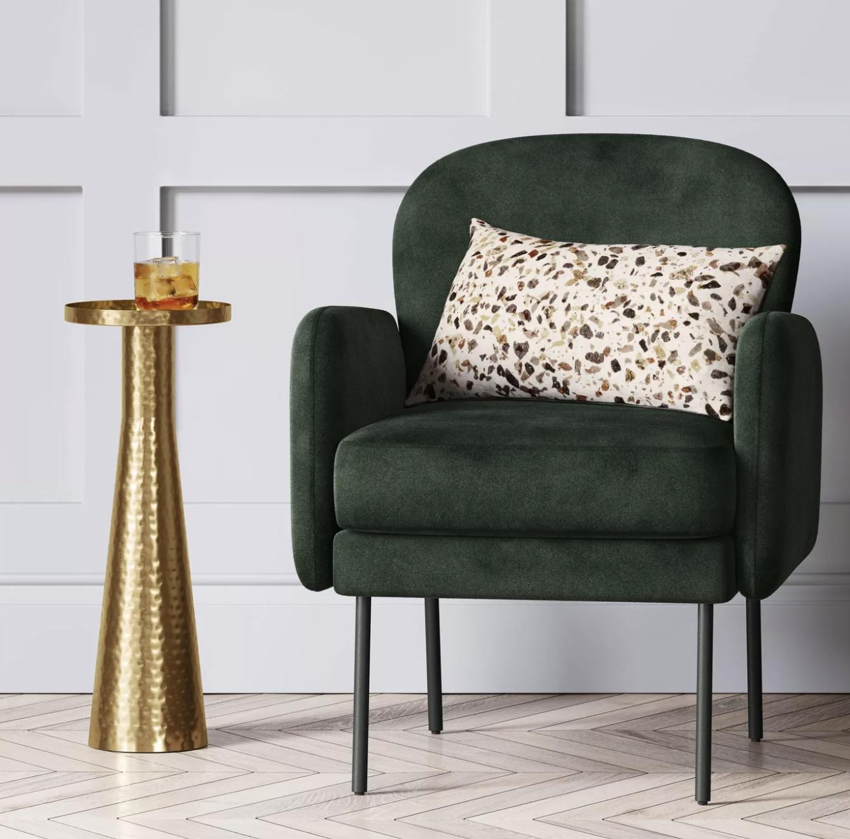 a green velvet accent chair