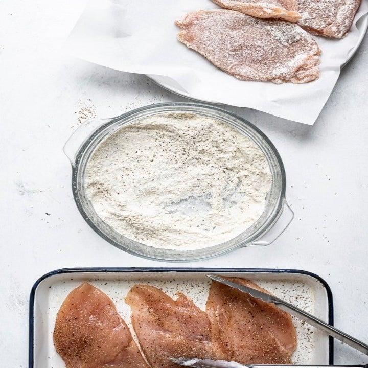 Breading chicken cutlets.