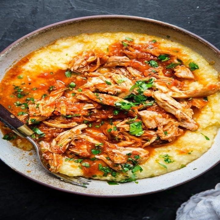 Shredded marinara chicken over polenta.