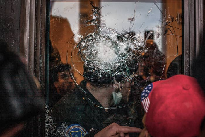 A broken window at the US Capitol during the insurrection