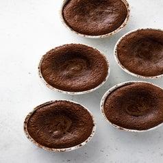 Chocolate cakes in ramekins.