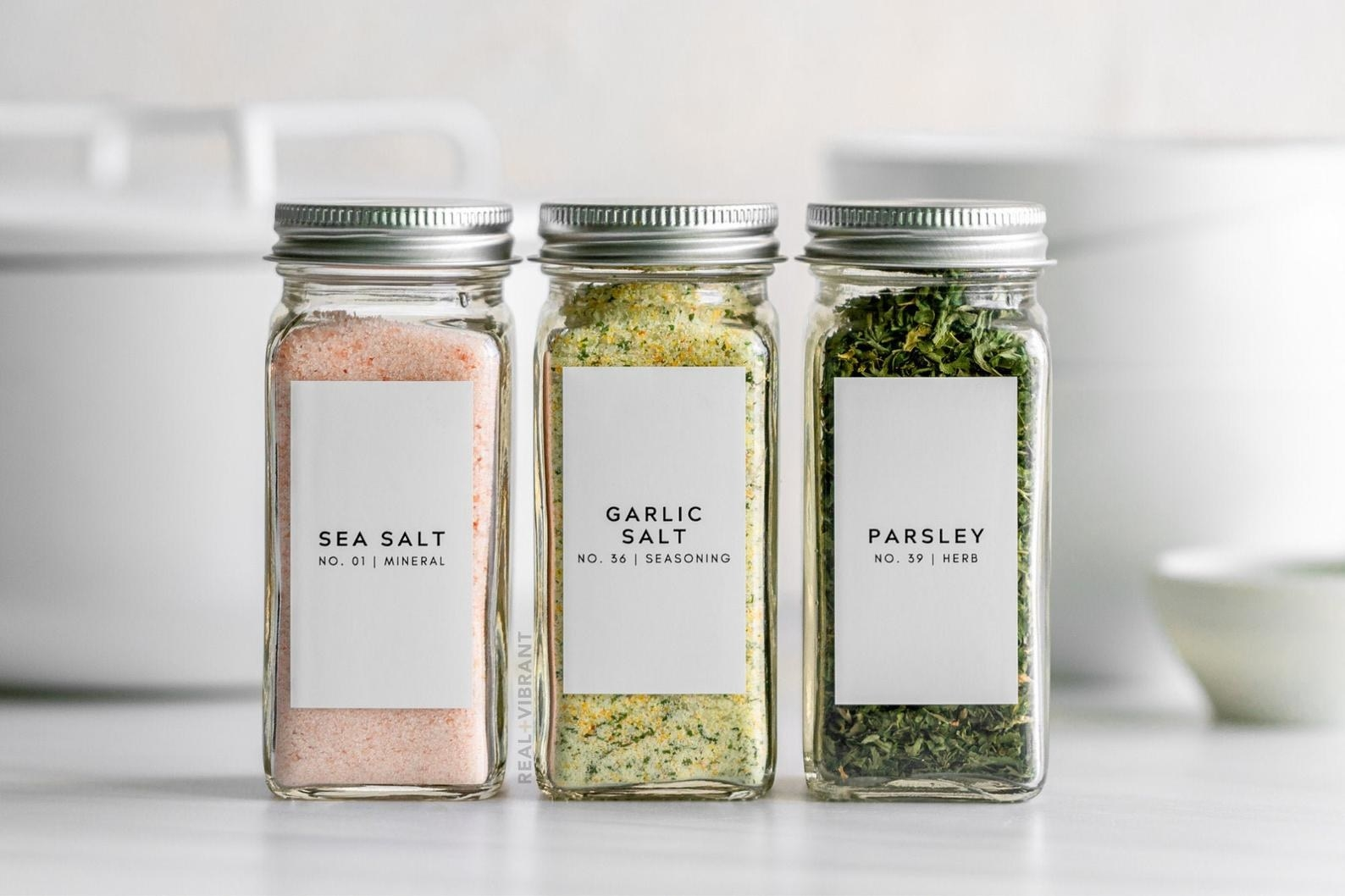the spice jars with sea salt, garlic salt, and parsley labels