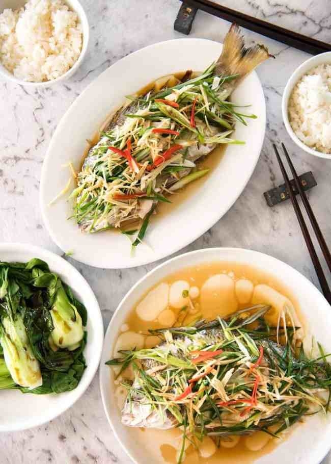 Two steamed fish with scallions and shallot ginger sauce.