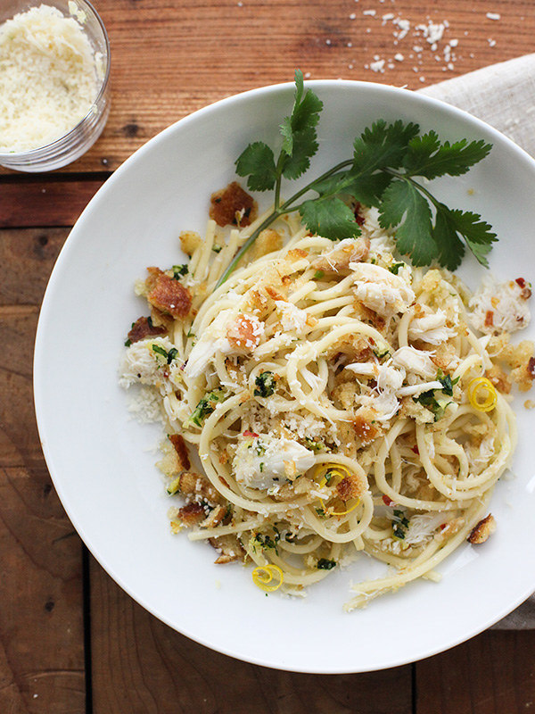 A plate of pasta with crab meat, lemon zest, and breadcrumbs.