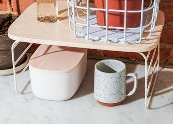 The shelf riser over a mug and storage container