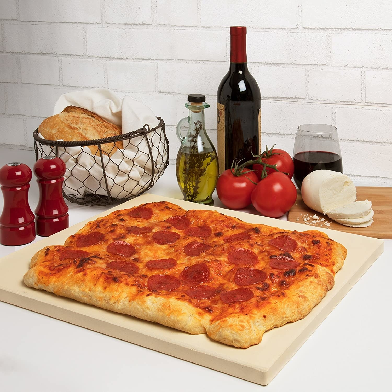 Large rectangular pizza on thick pizza stone