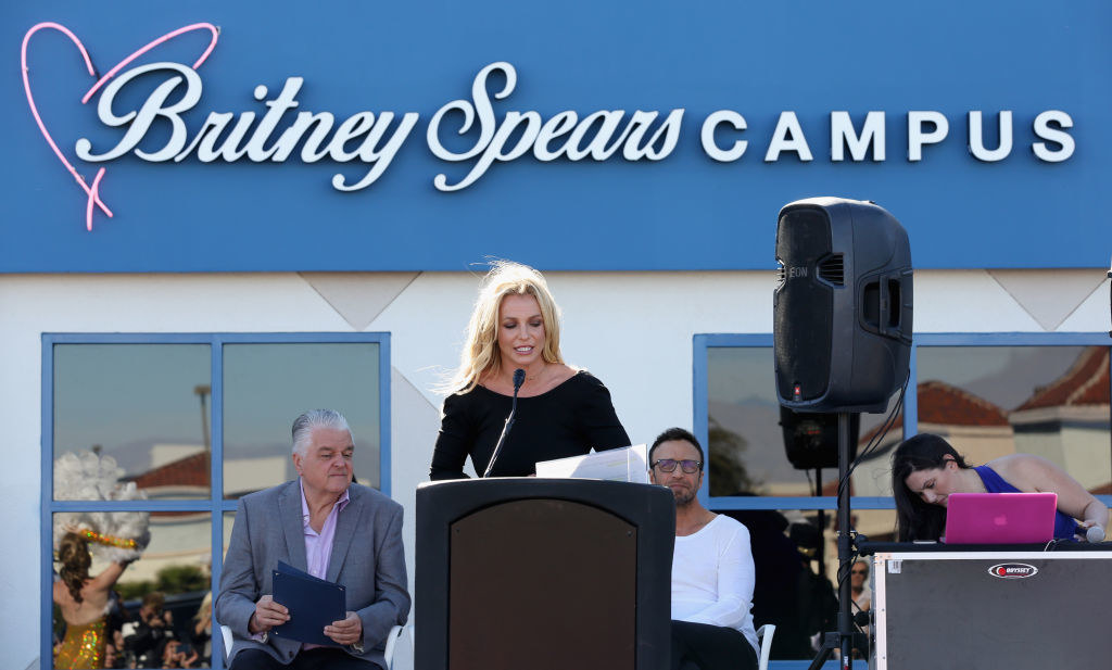Britney speaking in front of the Britney Spears Campus