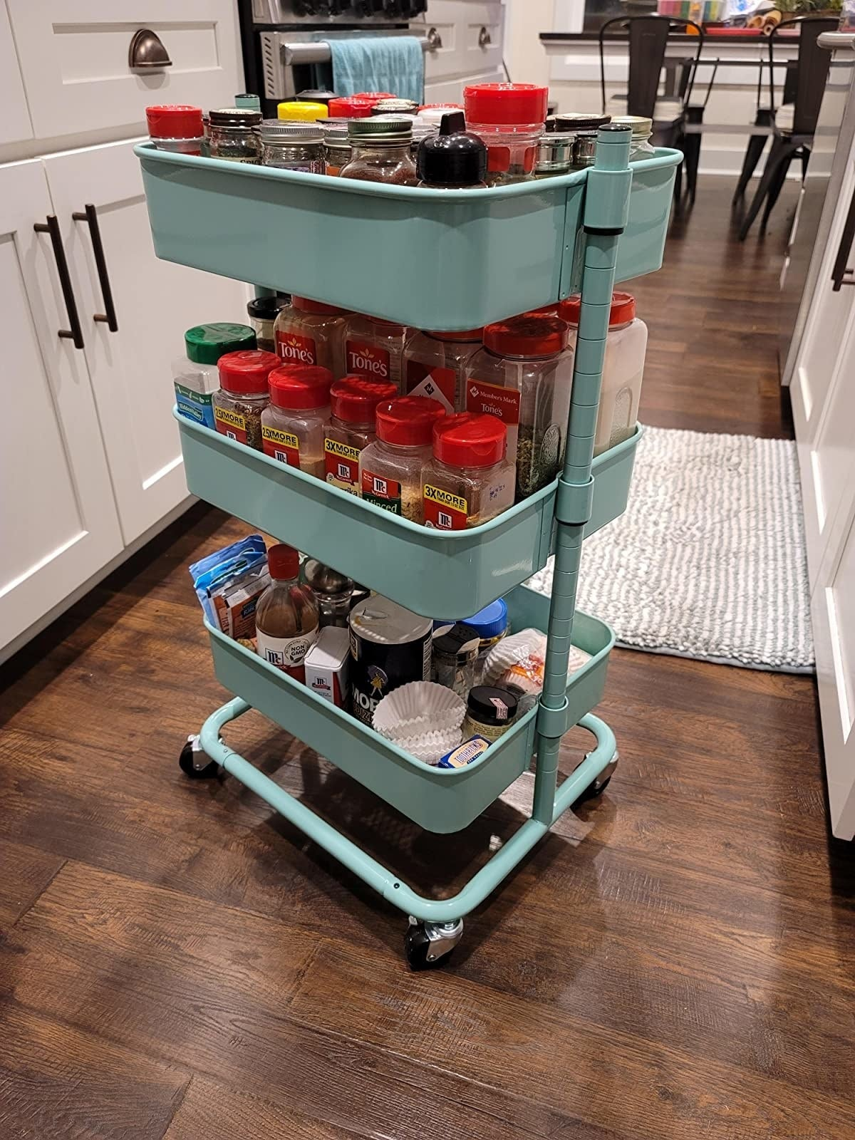 A reviewer using the aqua utility cart to hold pantry items