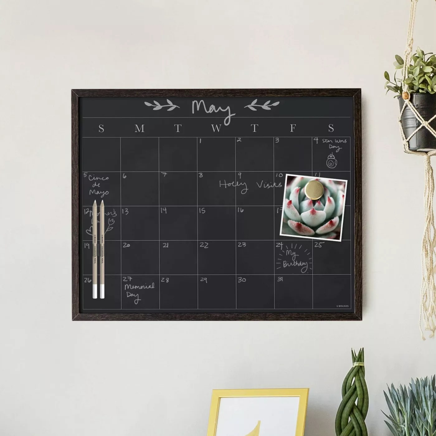 The calendar with its pens hanging on a wall