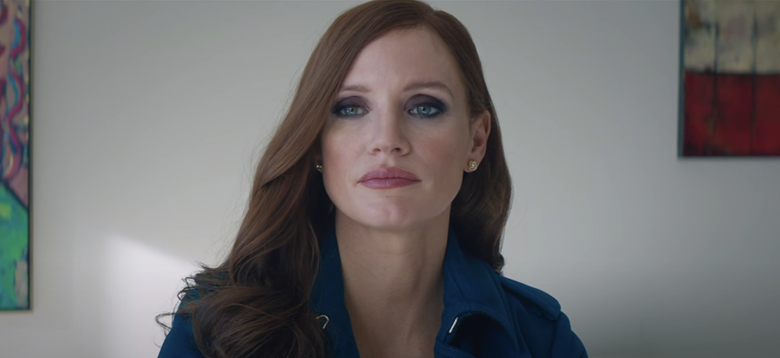 """Jessica Chastain stares blankly ahead as Molly in """"Molly's Game"""""""