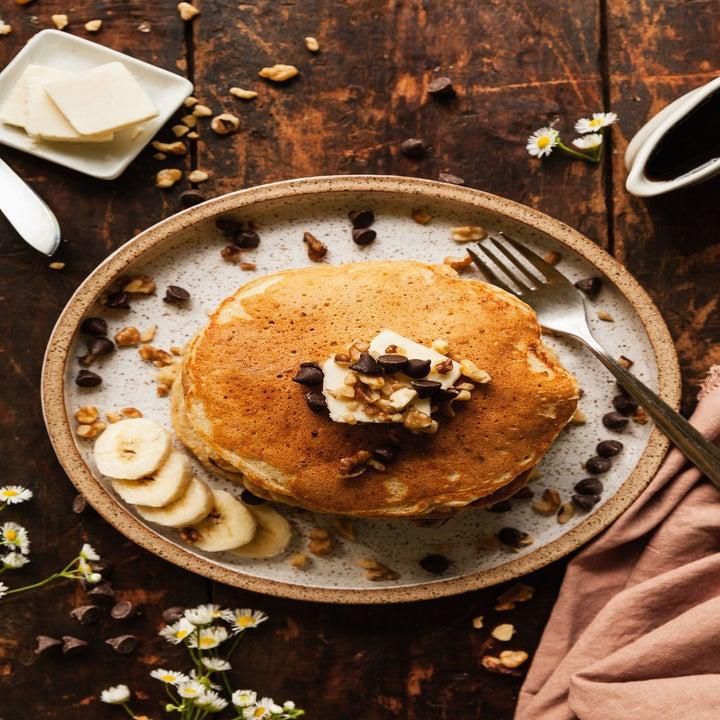 A stack of banana walnut chocolate chip pancakes