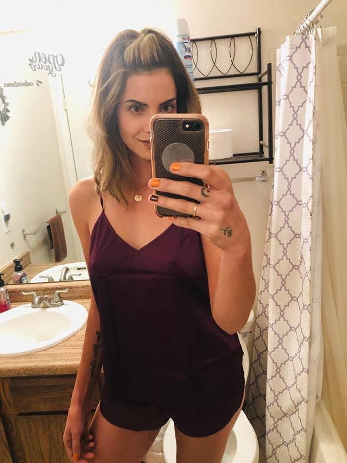 reviewer image of a customer taking a bathroom selfie in the wineberry ekouaer sleepwear set