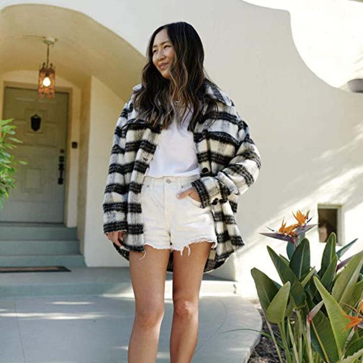 model wears shacket