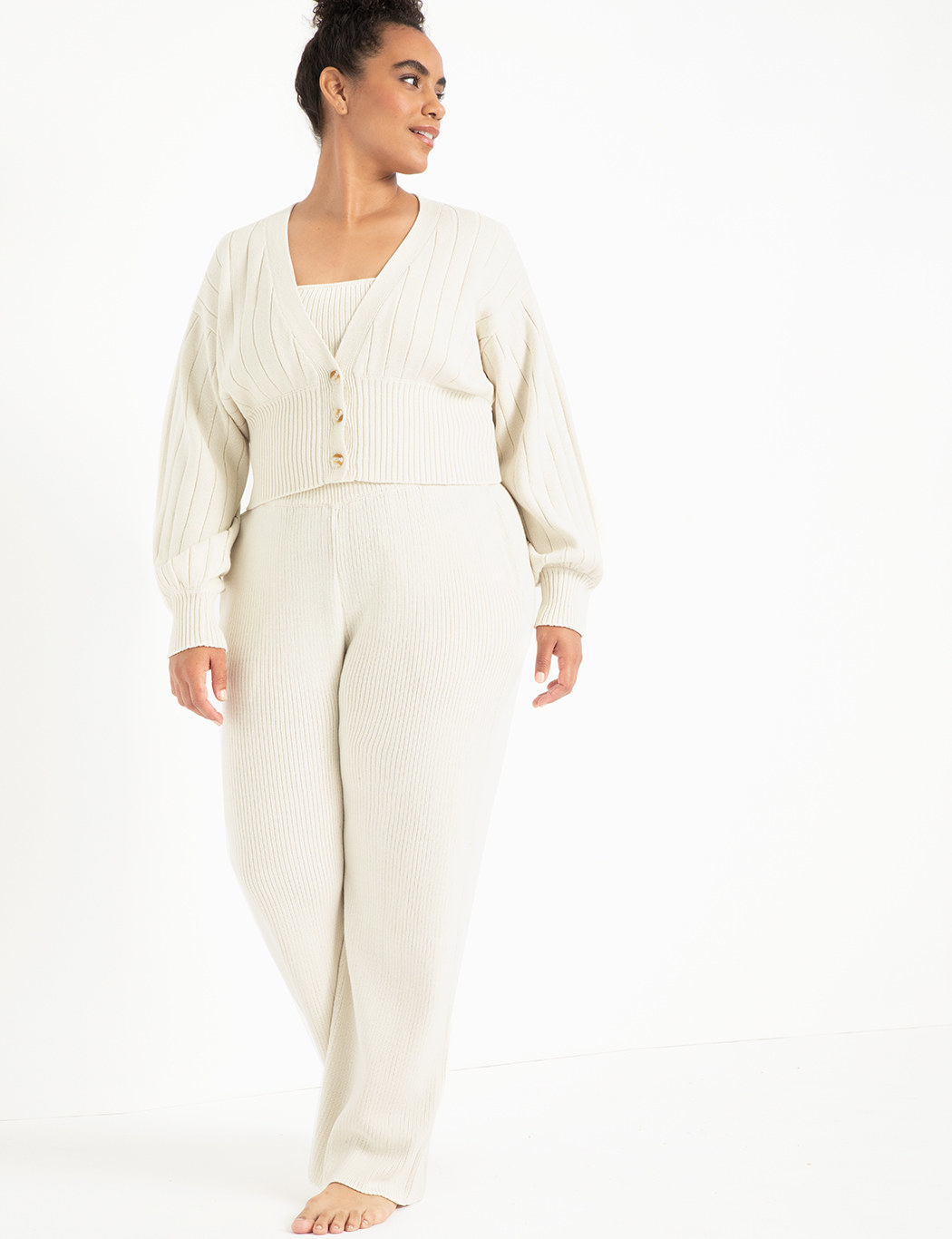 a plus size model wearing the complete knit set in antique white