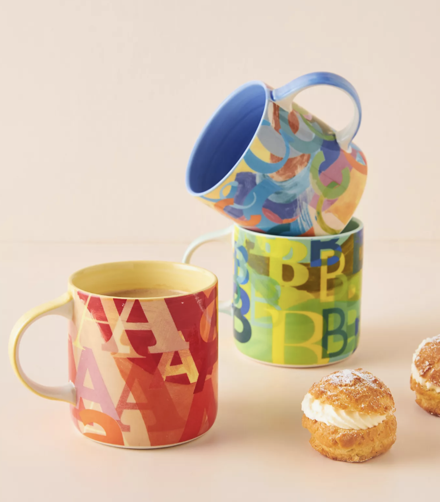 three mugs with different letters on each one