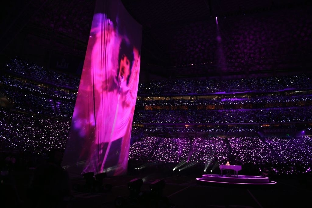 Prince is projected on a large screen as Justin Timberlake performs on stage during the Super Bowl LII halftime show