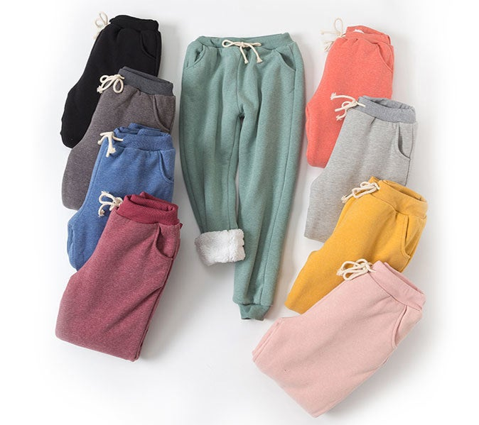 nine pairs of flygo fleece joggers in different colors