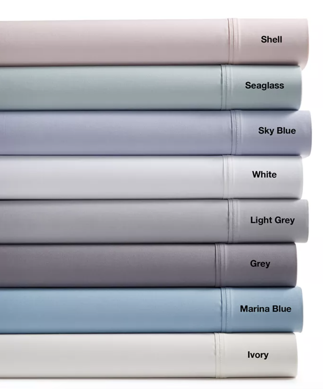 a stack of sheets in different colors