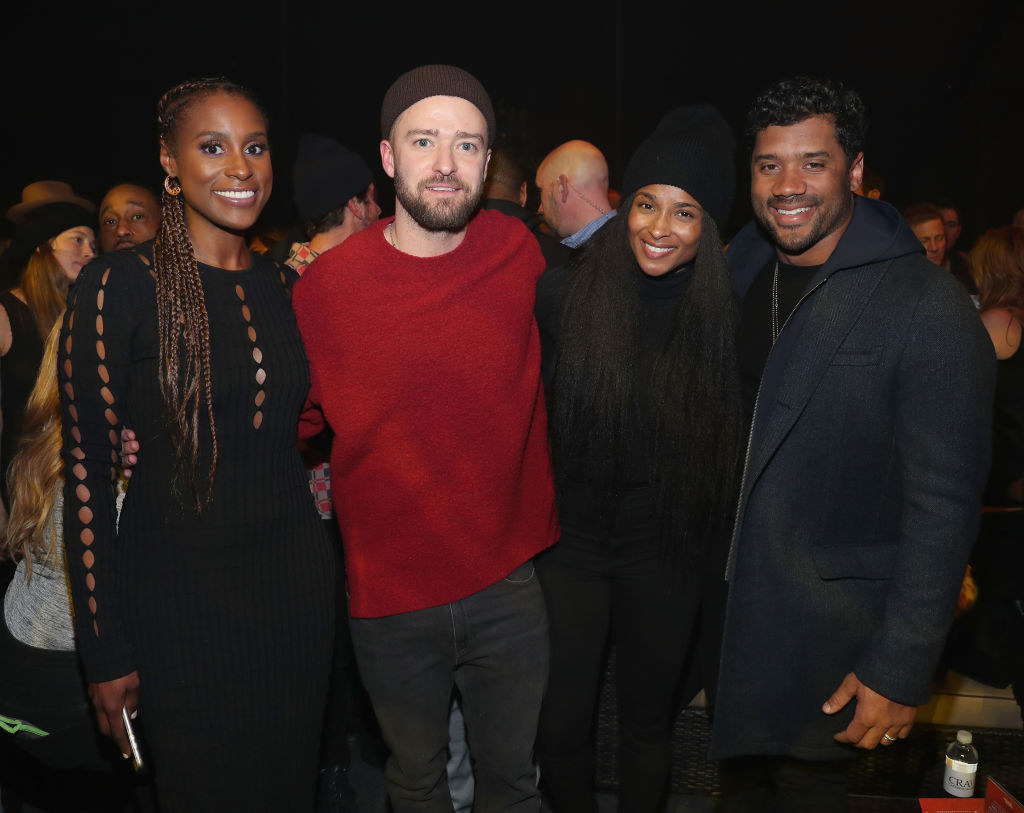 Issa Rae, Justin Timberlake, Ciara, and Russell Wilson posing for a picture