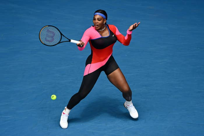Serena Williams wears a one-legged catsuit on the tennis court.