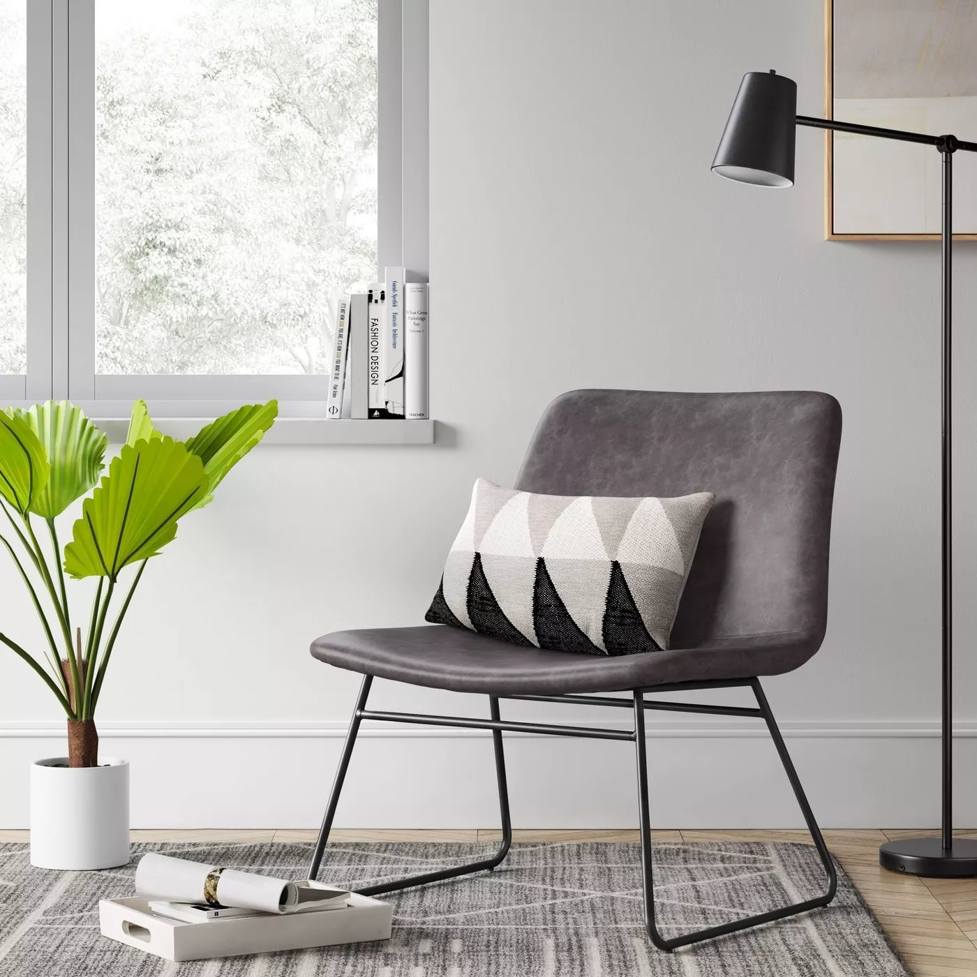 The gray accent chair in a study