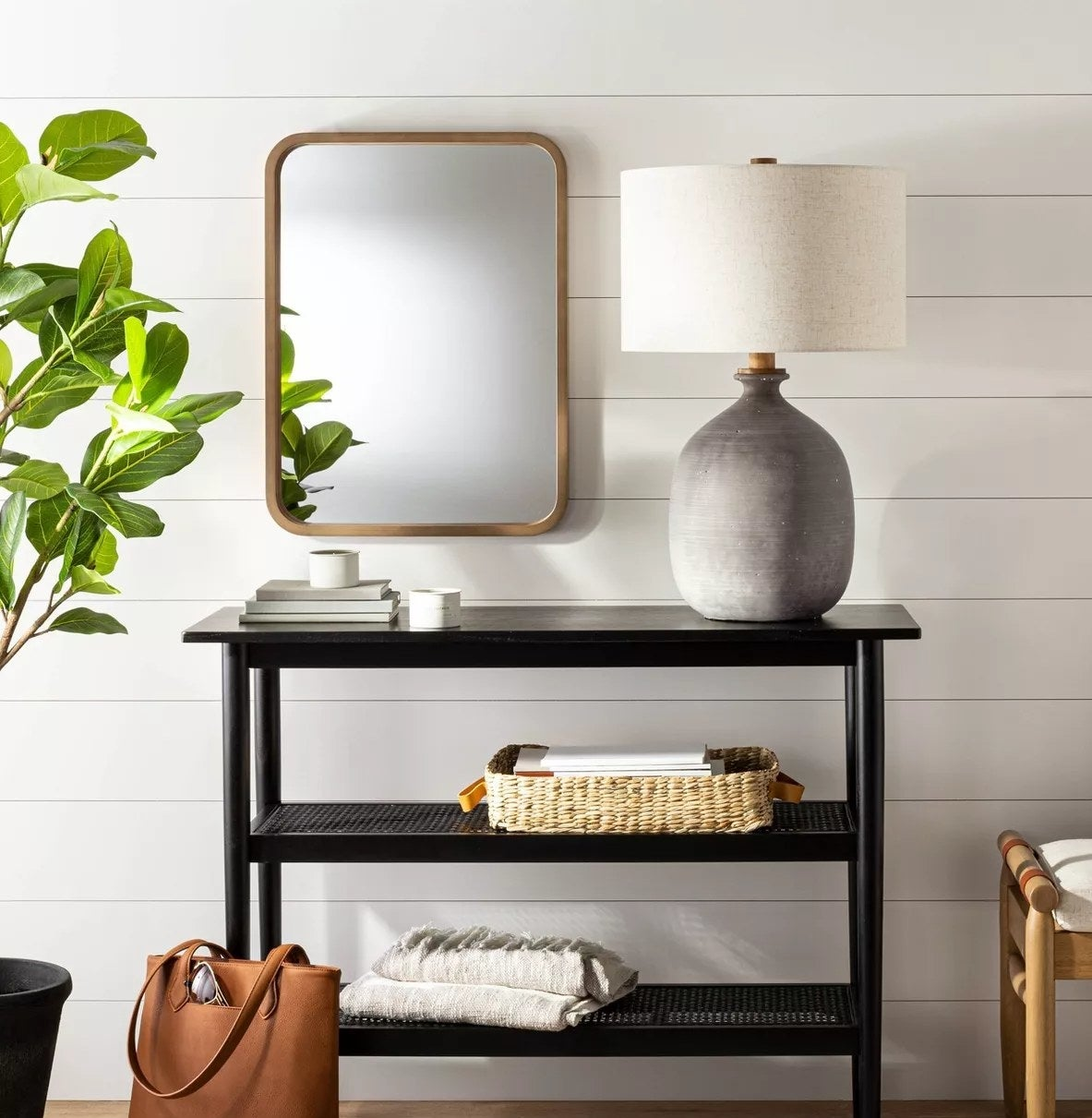The rectangular mirror in an entryway above a table