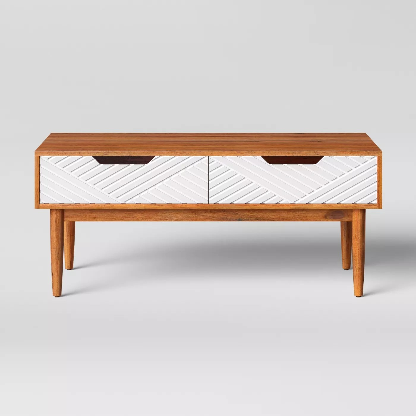 The wooden coffee table with white textured drawers