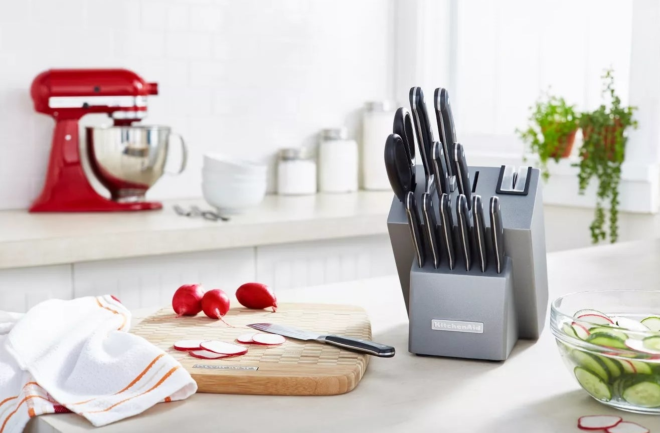 The knife set in its knife block on a kitchen counter