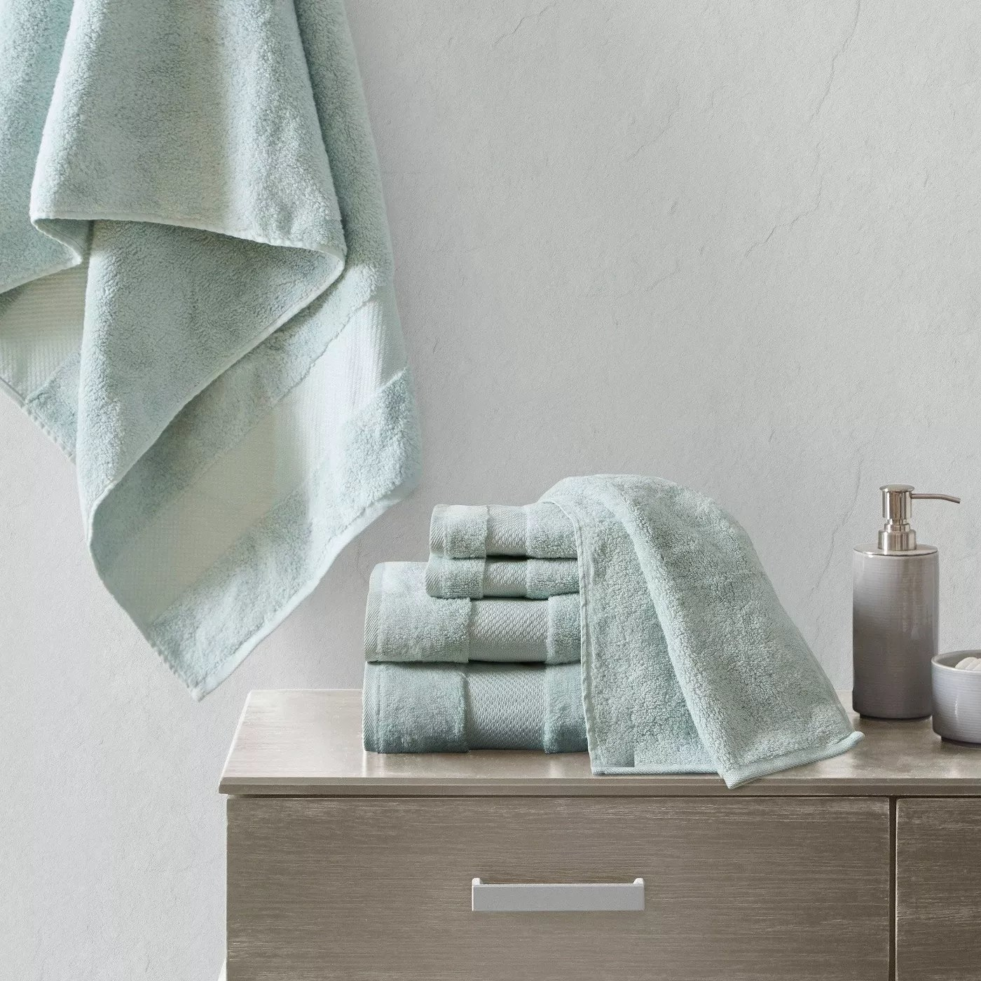 The light green towel set in a bathroom