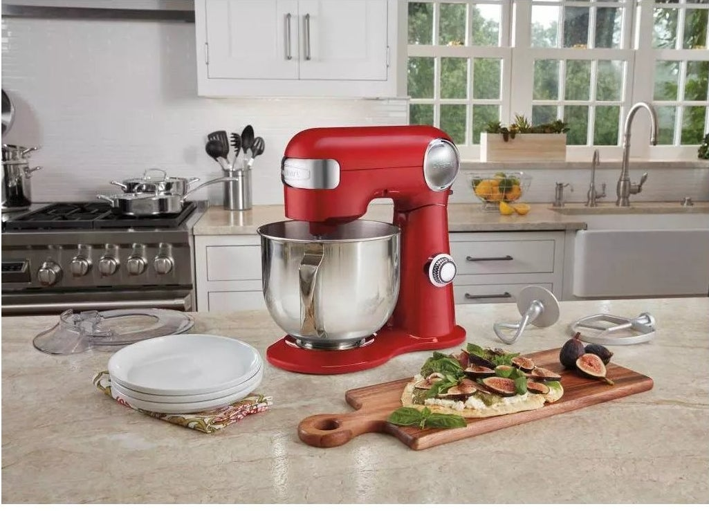 A red stand mixer on a kitchen counter