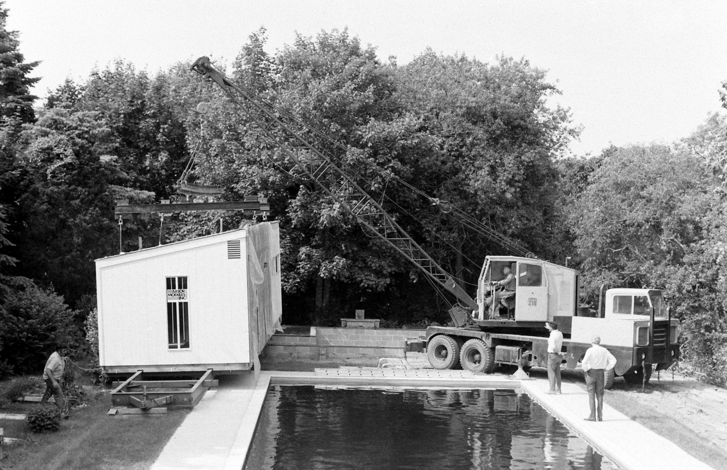 The construction of a private swimming pool in someone's backyard in the 1970s