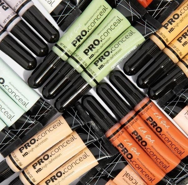 The concealer in green, orange, purple, and tan