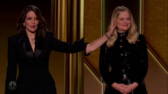 A split-screen image of Tina Fey and Amy Poehler in which Fey, in New York, pretends to be touching Poehler's face but it is really the hand of someone in Los Angeles
