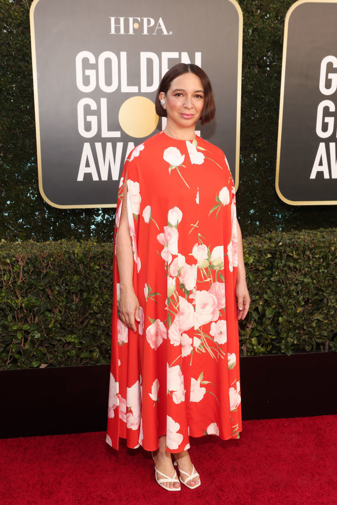 Maya on the red carpet in a floral print dress
